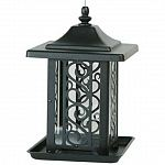 The Garden Gate Wild Bird Feeder is constructed of black, powder-coated and rust-resistant steel that is made to last. Beautiful metal design with clear container inside to hold seed. Feeder has a perch all the way around it for feeding multiple birds.