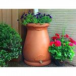Urn shape and color add class and style to your rain harvesting. Top functions as a planter which can leech overflow water from the rain barrel. Meshed screen blocks debris from entering your water supply. Flatback design sits tightly against any outside