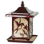This beautiful bird feeder features a hummingbird design that is consists of a high quality powder coated finish in red and is rust resistant. Design is featured on each side. Holds up to 5.5 lbs. of seed.