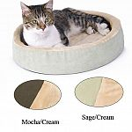 The Thermo-Kitty Cuddle Up is a heated bed to keep your cat comfy and cozy. This is an energy efficient low wattage heated cat bed. Washable. Available in 2 color combinations. Size 16