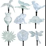 Metal stakes with acrylic topper Seven color-changing led lights illuminate at nightight Assortment includes 4 hummingbirds, 4 fairies, 3 gnomes, 3 lighthouses, 3 owls, 2 birds, 1 sunflower, 1 begonia, 1 butterfly, 1 turtle, 1 frog, 1 dragonfly. Runs up t