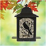 Features a detailed screen printed design of birds & berries on all four sides. Holds up to 5 pounds of seed and has 4 feeding stations. Powder coated black finish. Sure-lock cap system that keeps squirrels out. Bird-preferred u-shape perches.